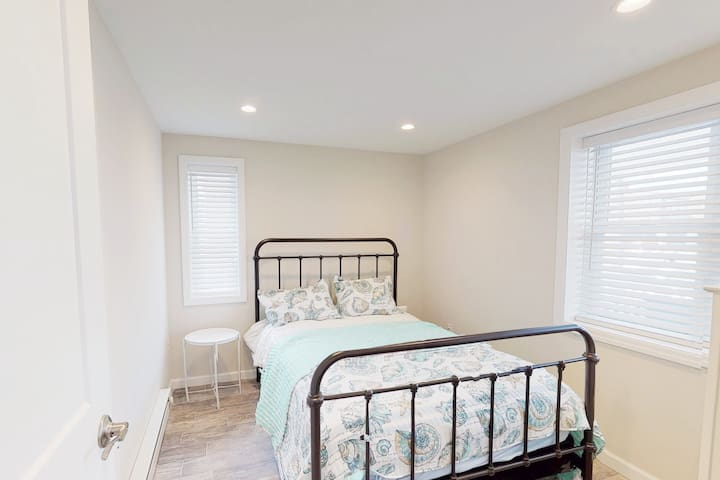 The third  bedroom (at front of house) features a full bed, 4 drawer dresser, side table for drinks and phones, luggage rack and pull out clothes hanger.