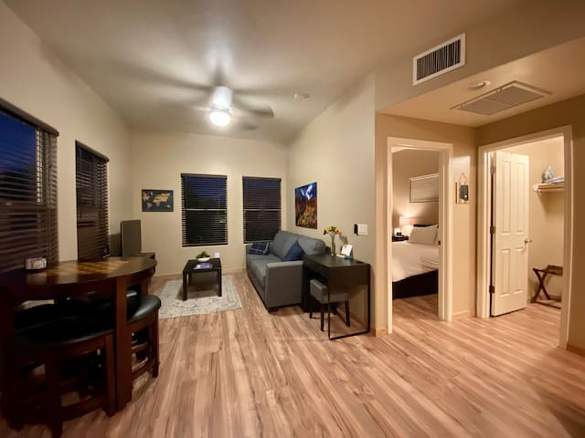 """The living room has a sofa/sleeper bed with a gel top mattress.  Watch cable TV on the 43"""" 4k smart TV equipped with Netflix, HBO, Showtime, Cinemax and Starz. The table on the left is a game table with drawers which holds chess pieces and cards."""