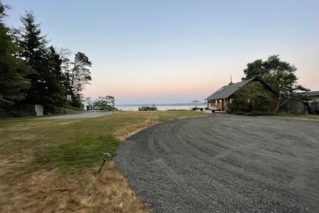 Large level parking area providing direct access to deck. Private road, license plates of approved quests only allowed. If you wish to have a large gathering contact host as options are available.