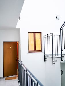 The barrier-free apartment is on the first floor which you can reach with the wide lift or 2 wide stairs.