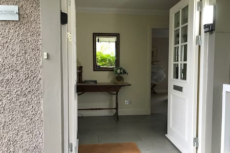 "The front doors open to 26"" (66cm) single leaf and 54""(137cm) with both doors open. The hallway is 60""(152cm) wide at its narrowest, and has level access from the entrance porch/patio, and level access to the master bedroom and the living room."