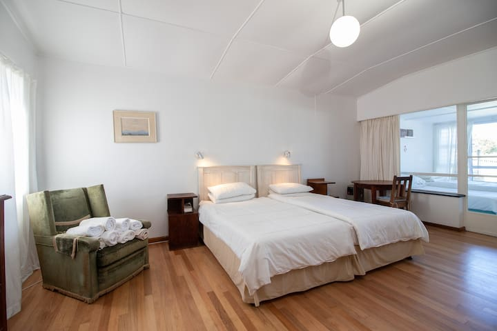 Main Bedroom with adjacent/inter-leading room with two single beds. The two rooms are separated by curtains and a glass door which can be locked. There is an separate entrance into this inter-leading room from the lounge.