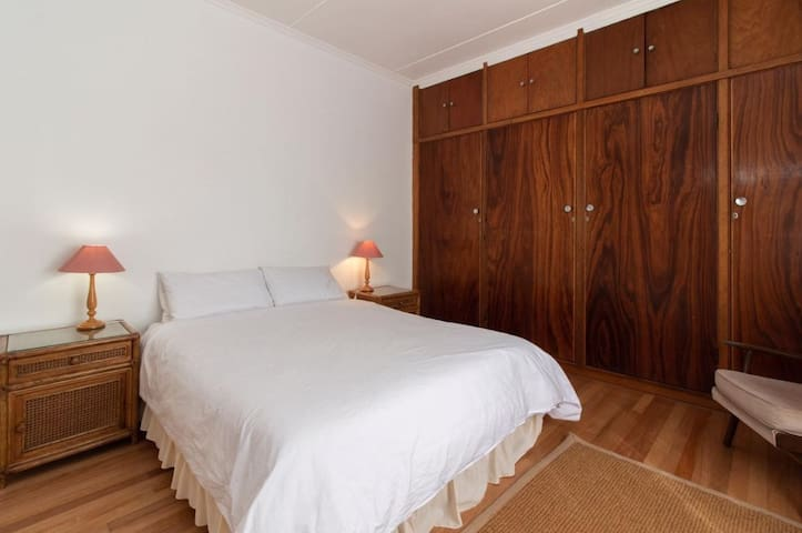 Second bedroom with double bed and ample cupboards