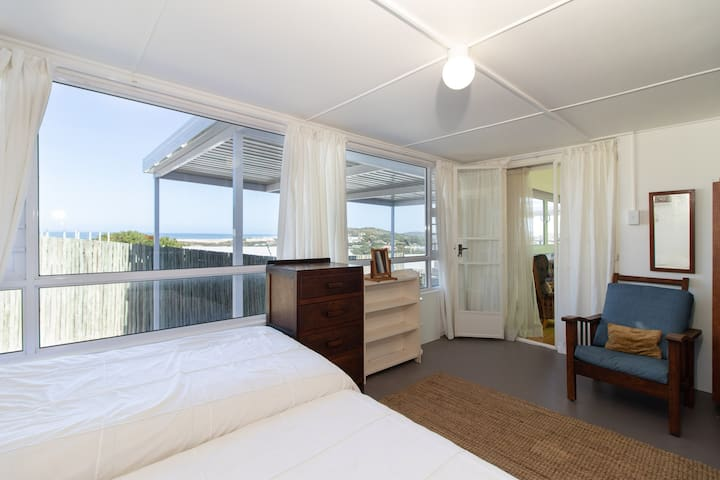 Second bedroom, with views. Two single beds. This room is inter-leading/adjacent to main bedroom. Suitable for families or can be used as a separate bedroom with the inter-leading door locked and the 2nd bedroom accessed through the lounge.