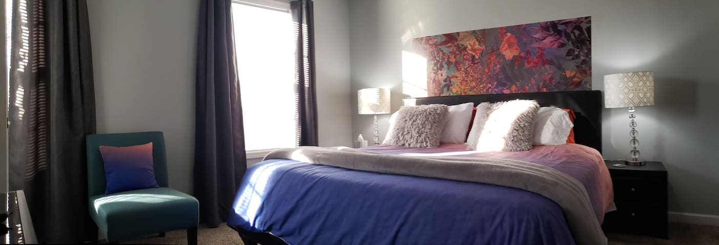 Light, bright, colorful contemporary Master bedroom right here in Crossville.