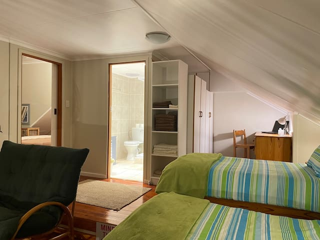 Upstairs open space with two single beds