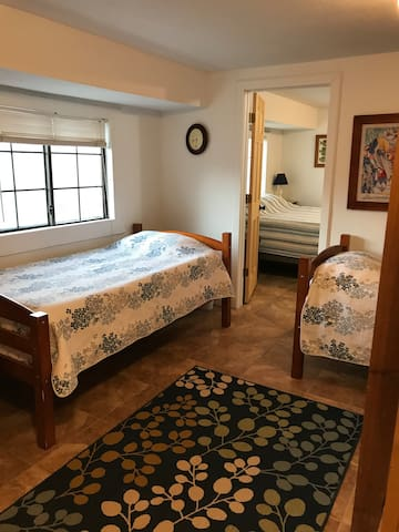 Downstairs entrance room with two twin beds (one under the stairway)