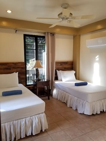 Guest room features two twin beds and AC.  Twin beds can be put together to make an additional king sized bed if requested.    Beach towels can be found on the beds at check in.