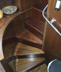 Stairs inside leading from the salon down to the galley