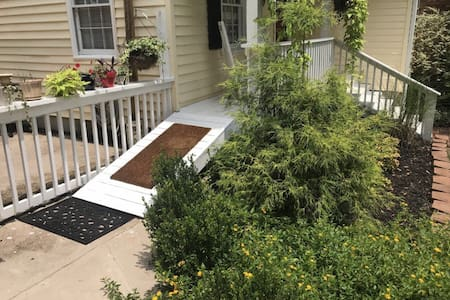 Well lit ramp to front door