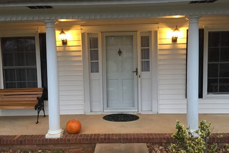 "The front door entrance is a 36"" wide opening. There is one 4"" step from the walkway onto the porch."
