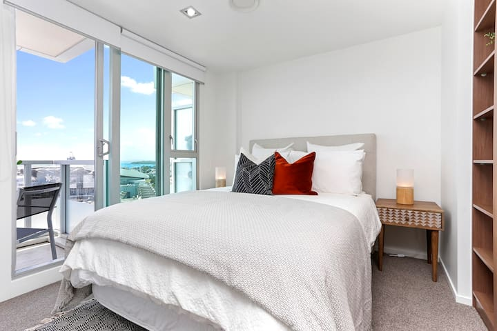 Second bedroom with gorgeous natural light and access to balcony. This bedroom also has ample storage space