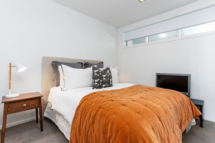 First bedroom with high quality bed and linen for a dreamy nights sleep