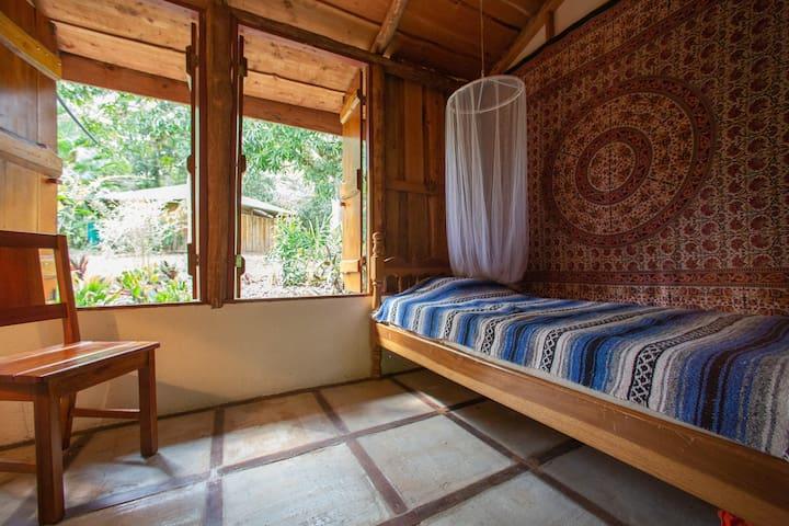 Single bedroom with cedar shutters only.