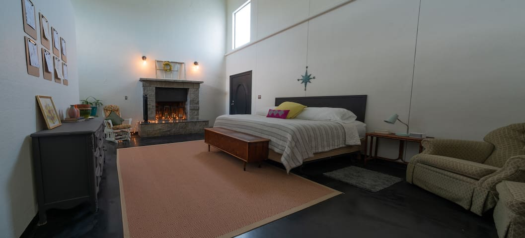 Relax & retreat in the master suite that is located downstairs complete with fire place, private patio, master walkin shower and jetted tub.