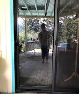 The sliding glass door to enter