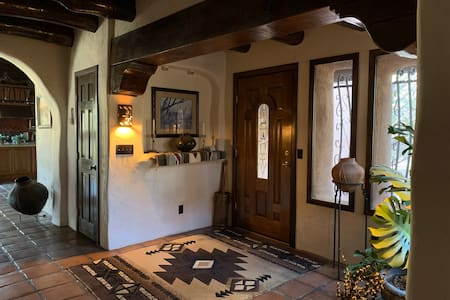 A wide doorway into a large and tiled foyer. Easy to access