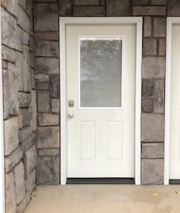 Wide entry with direct access to driveway