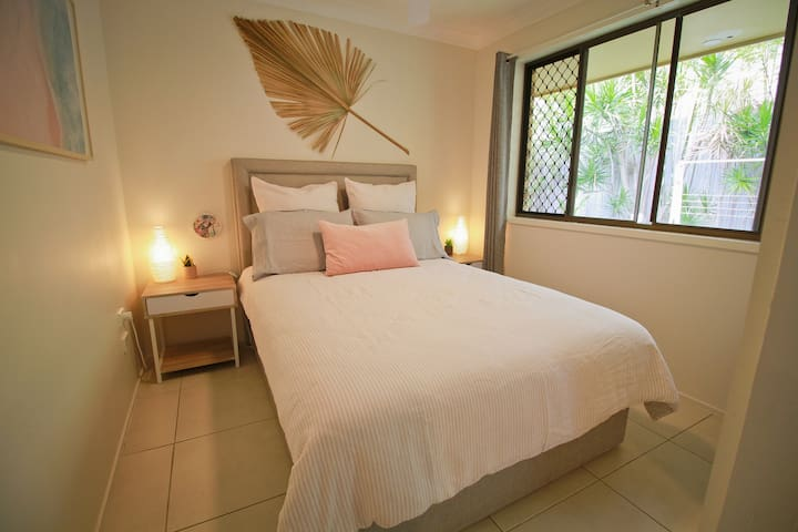 The second bedroom contains a double bed, wardrobe and ceiling fan.