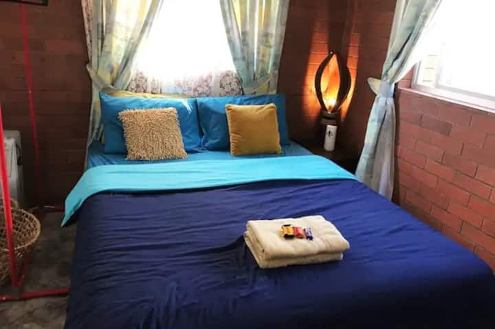Deluxe Carpeted Room