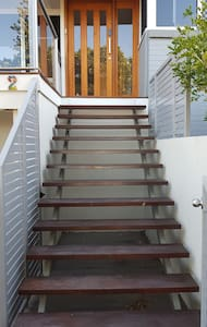 Front entrance , 900mm wide, with a light at the top and bottom of the stairs