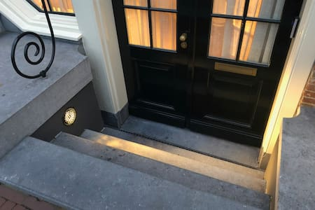 Steps to the entrance door are illuminated daily from sunset.