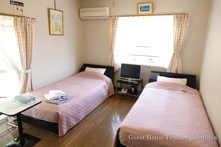Bed Room with 2 Single Beds, Shower and Toilet