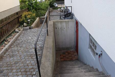 Stairwell to studio apartment outside door