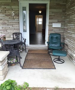"""Only for walkers not suitable for wheelchairs. One step (6"""" high) at the entrance door and one step (4"""" high) which is 8 feet away from the front door.  No slopes. Door size is 35"""" wide.  Well lit inside and outside."""