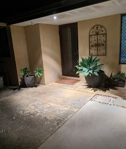 Motion sensor activation of outdoor lighting across the front of the house and entryway