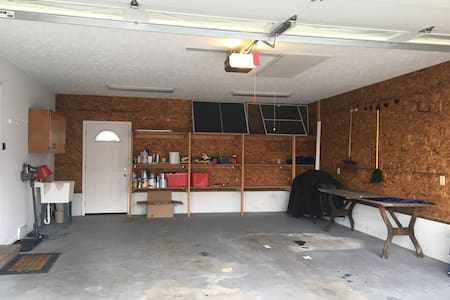 You can drive into garage and enter with a 6 inch step from garage into house