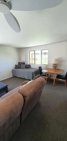 2nd lounge, has a king single bed and day bed