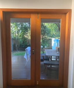 Private entrance. Both doors open up to deck.