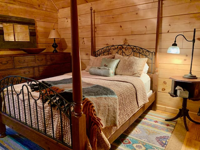 Very spacious upstairs bedroom with high vaulted ceilings