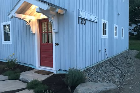 The front entry door ! There is a slight 2inch step up to door sill . Less than 10 ft from parking to front door . Bedrooms  & bathroom on ground floor . Entry hall has a antique porcelain sink in addition to bathroom sink . Washer/dryer on ground fl