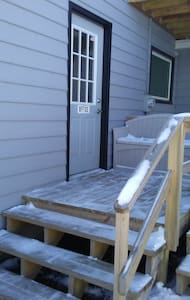 Guests park in back of home and enter through this door.  There is a RING video camera with motion sensor light outside the door.  There is also an awning over the door.  If needed, we have a wheelchair ramp to place over the 2 stairs.