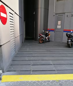 Car can drive to side of building to drop off at drive way. The yellow line is gentle ramp up, from drive way to rear porch,  where you can see the motorcycles, then turn right, open glass door into service corridor, passing by security room.