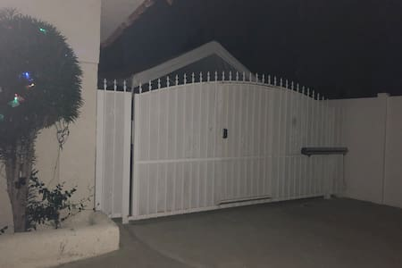 White gate door to enter property
