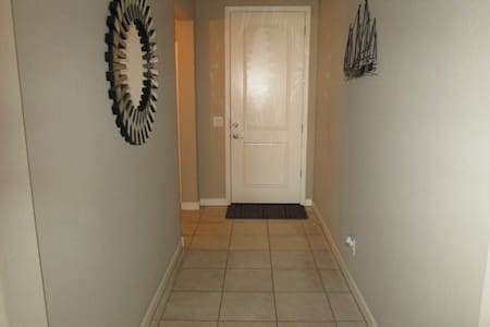 The front door as seen from the inside. At least 36 inches wide in the hall way