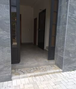 Entrance to the building with elevator in the background