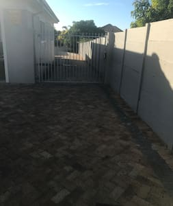 Wide entrance for car behind electric gates