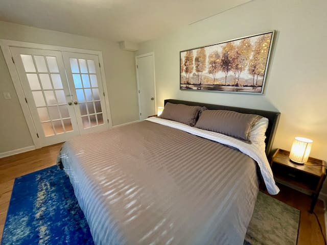 First floor master suite with king-sized bed.