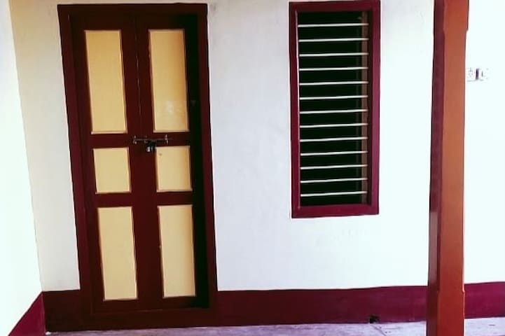 Third Bedroom with comfortable wooden single cots with cotton beds