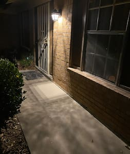 There are no ramps or stairs to get to the front of the house. There is a clear, lit path to the door way.