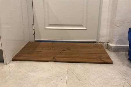 No steps on the outside footpath. This is the small ramp into the living room / kitchen. The front door is 80cm wide
