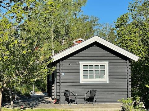 Mysig stuga på Resarö Vaxholm, Stockholms skärgård