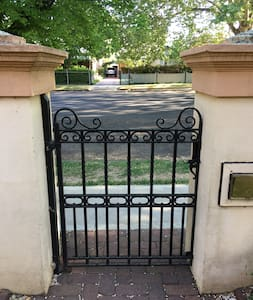 The sturdy and heavy cast iron front gate is standard width wide.