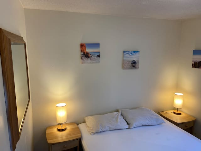 Bedroom w/queen-sized bed, Himalayan salt rock lamps, beach decor, cozy decor & ambiance lighting. Full length mirror & AC in bedroom.