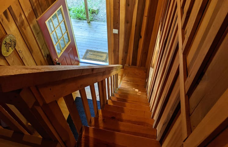 Steep stairs leading down from the upstairs sleeping loft.