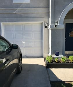 Private garage entry with no steps.